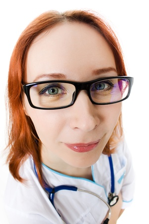funny young female doctor on white background photo