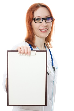 Smiling medical doctor woman holding blank billboard  isolated on white photo