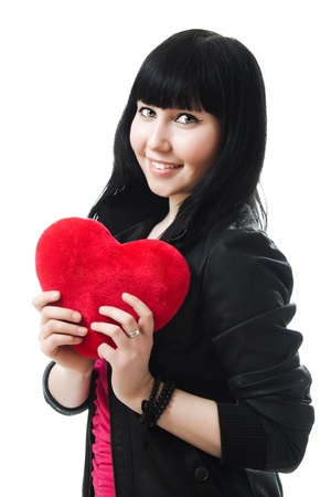 A beautiful woman with a heart on a white background. photo