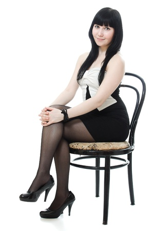 people sitting: Sure beautiful woman in evening dress sitting on a chair on a white background