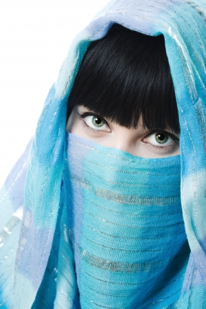 arab glamour: Close up picture of  woman wearing a veil on a white background. Stock Photo