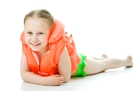 lifejacket: Young girl with yellow lifejacket on a white background.