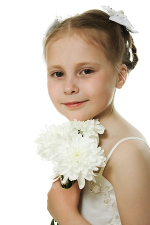 Beautiful girl in white dress with a flower on a white background.