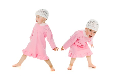 restless: Two little girls twins restless on the white background. Stock Photo