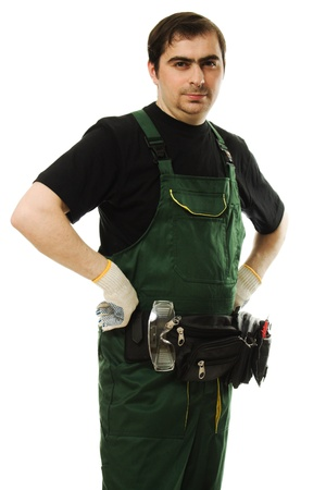 Male worker with tools on a white background. photo