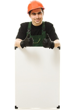 Senior constructor holding the blank board on a white background photo
