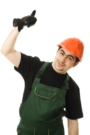 Businessman in helmet pointing up on a white background. photo
