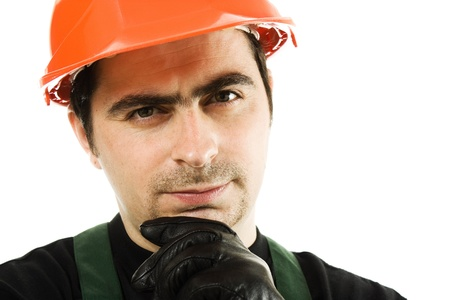 Thinking businessman in the helmet on a white background. photo