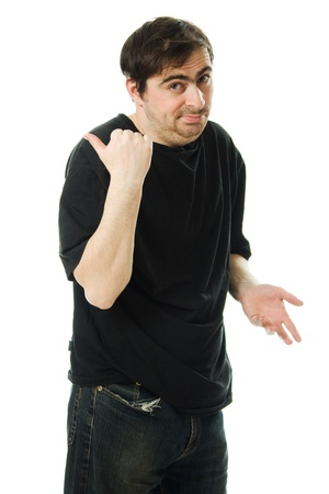 slut: man in a black T-shirt points a finger behind his back on white background