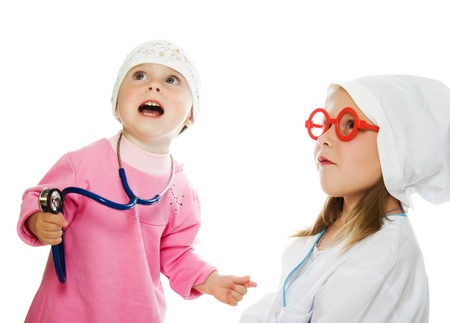 merry children playing as doctor and patient on a white background. photo