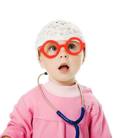 Little baby with glasses and with a stethoscope is a doctor on a white background.