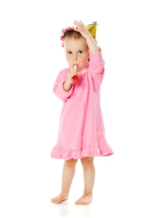 A girl in a pink dress and a hat on his birthday on a white background. photo