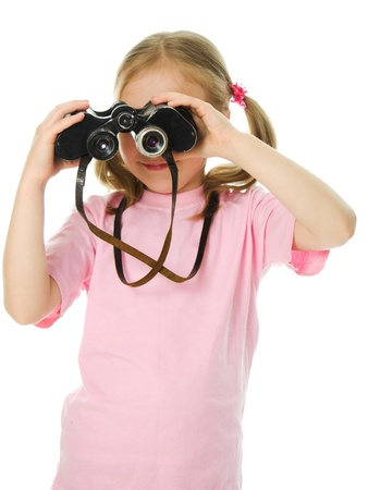 Little girl with binoculars on a white background. photo