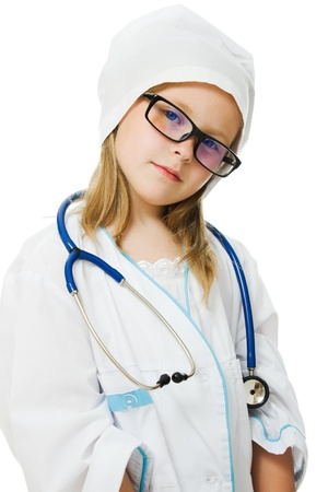 Cute little girl is playing doctor with stethoscope, isolated over white photo