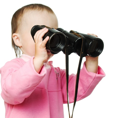Little baby with binoculars on a white background. photo