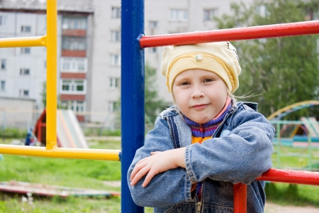 attractive little girl on outdoor playground equipment photo