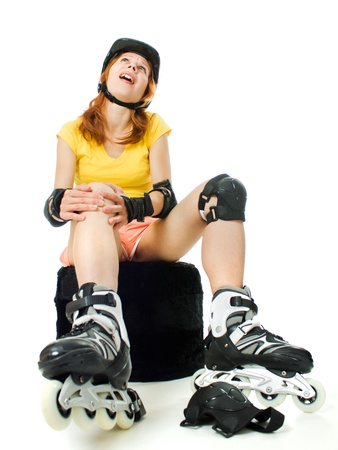 beautiful young woman on roller skates on a white background. photo