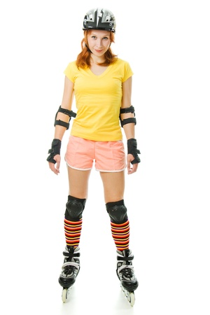 beautiful young woman on roller skates on a white background. Stock Photo - 14623981