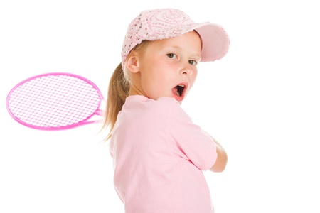 sports attire: little girl with plays tennis  on a white background