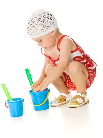 Cute baby with bucket and spade isolated on white Stock Photo - 14779539