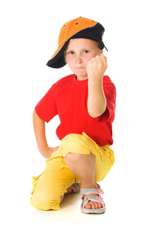 threatens: Little child threatens with a fist on a white background