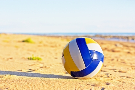 Volleyball in the sand with at the beach. Stock Photo
