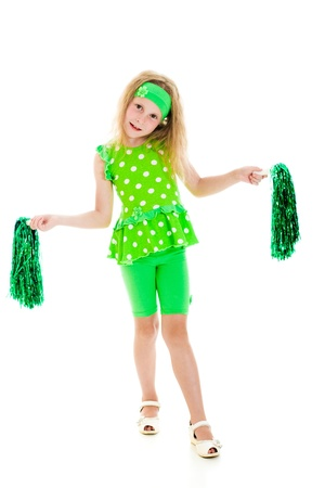 pep: The girl in green over white with pompoms.