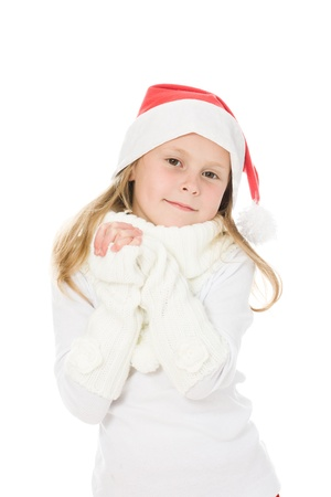 Cute little girl in the santa claus hat on a white background.