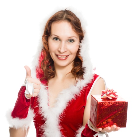 Happy girl in a Christmas dress showing okay sign on a white background. photo