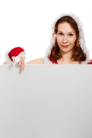 Beautiful woman in Christmas clothing points the finger at clean background. Stock Photo - 15646995