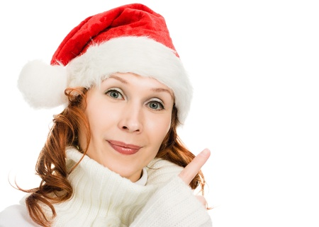 Beautiful Christmas woman in santa hat showing finger up on a white background. Stock Photo - 15647001