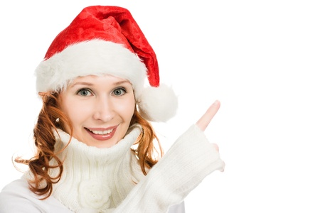 Beautiful Christmas woman in santa hat showing finger up on a white background. photo