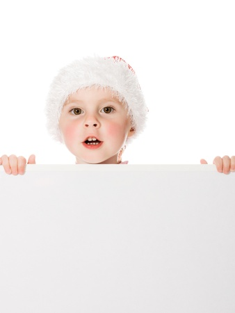 Happy Christmas child with the board on a white background. Stock Photo - 15646978
