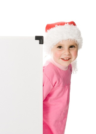 Happy Christmas child with the board on a white background. photo