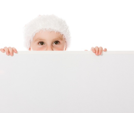 Happy Christmas child with the board on a white background. Stock Photo - 15646972