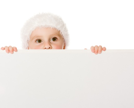 Happy Christmas child with the board on a white background. Stock Photo - 15651137