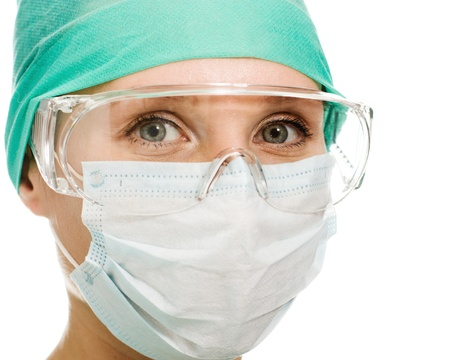 surgeon: Surgeon woman in protective glasses and mask on whites background.