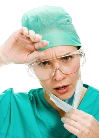 Surgeon woman sighs wearily on a white background. photo