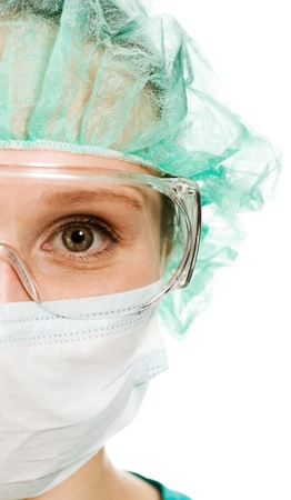 Surgeon woman in protective glasses and mask on whites background.