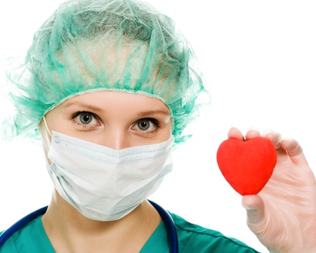 surgical cap: Woman doctor with a heart in his hands on a white background