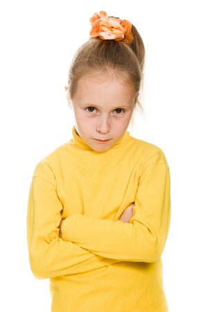 Little girl taking great offended on a white background. Stock Photo