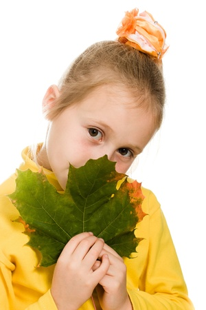 shy girl: Shy girl with green maple leaf in his hand on a white background. Stock Photo