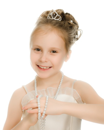 costume jewelry: Beautiful girl in white dress on a white background.