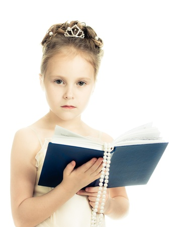 Pretty beautiful girl with a prayer book and a rosary on a white background. photo
