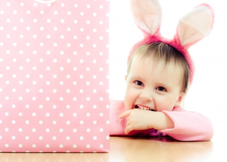 The little girl with pink ears bunny and bag on white background. photo