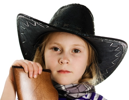small butt: A girl in a black hat cowboy leaning on a rifle butt on a white background.
