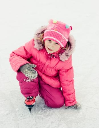 The girl in the skate on the ice. photo