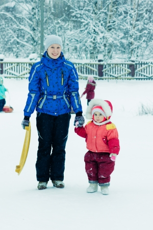 Mother with baby on the sled. photo