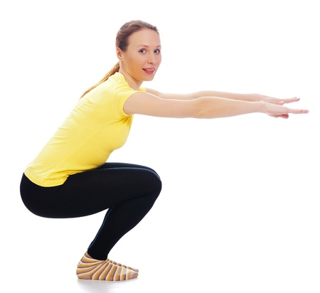 Young woman doing yoga exercise on a white background. Stock Photo - 19193958