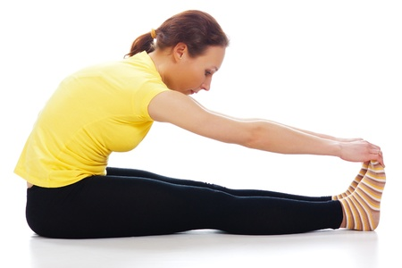 Young woman doing yoga exercise on a white background. Stock Photo - 19193987